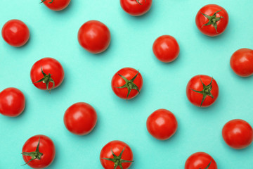 Flat lay composition with ripe tomatoes on color background