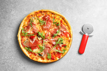 Delicious pizza with meat on light background, top view