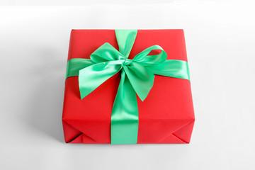 Beautifully wrapped gift box on white background