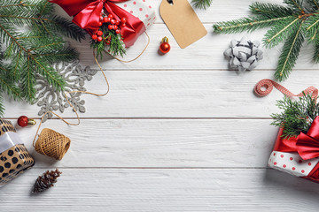 Flat lay composition with Christmas gifts and decoration on wooden background