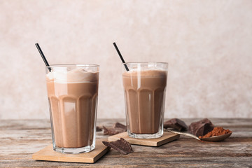 Tuinposter Milkshake Glasses with chocolate milk shakes on wooden table