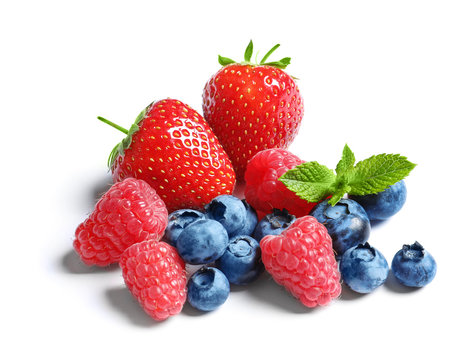 Raspberries, strawberries and blueberries on white background