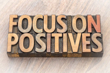 focus on positives - word abstract in wood type