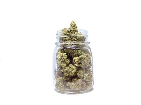 Marijuana in Jar Isolated white background