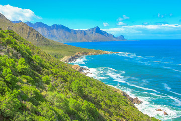 Scenic coastal R44 on eastern part of False Bay near Kogel Bay Beach between Gordon's Bay and Pringle Bay in Western Cape, South Africa. Beautiful mountain scenery along Route 44 in summer season.
