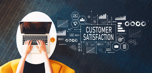 Customer Satisfaction with person using a laptop on a white table