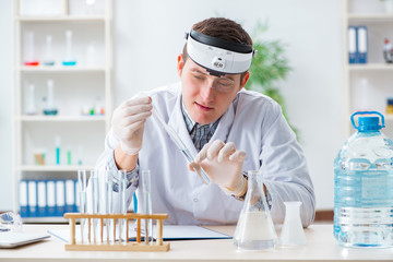 Young chemist student experimenting in lab