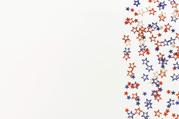 4th of July American Independence Day blue and red stars decorations on white   background. Flat lay, top view, copy space.Red and blue stars border for American Independence