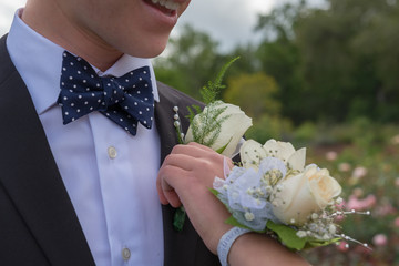 pinning boutonniere and corsage for prom or formal
