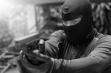 Close up men's commando who is holding guns