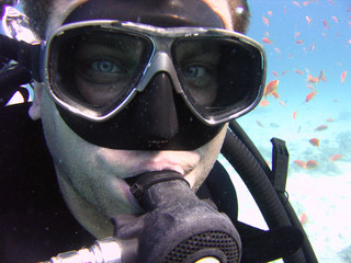 Underwater photo, face of scuba diver