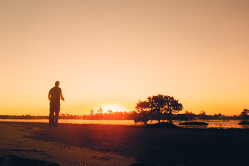 Human silhouette at sunset