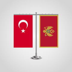 Table stand with flags of Turkey and Montenegro.Two flag. Flag pole. Symbolizing the cooperation between the two countries. Table flags