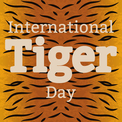 International Tiger Day. July 29. Wild mammal is an animal. Cartoon style. The name of the event, background the texture of the coloring of the tiger fur