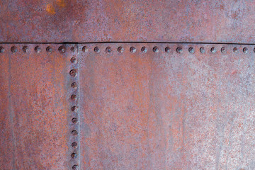 Hand Hammered Rivets in Rusty Steel