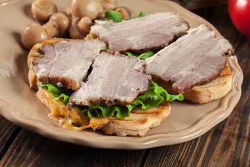 Sandwich with baked pork belly