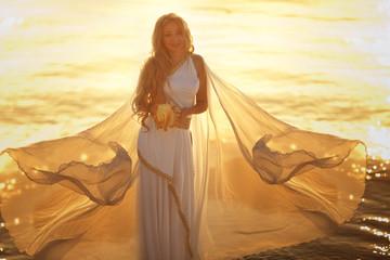 Beautiful girl in a long white wedding dress in Greek style is the old Greek goddess