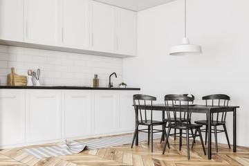White kitchen corner, black table, wood