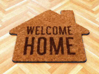 House shaped Welcome mat on wooden floor