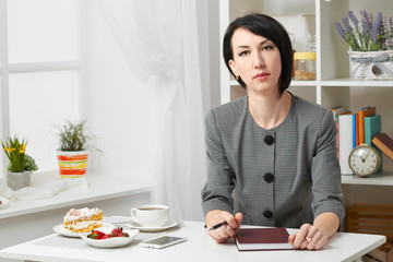 portrait of a business woman in a white interior