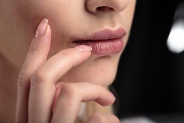 Closeup macro photo of woman's lips with natural lip balm