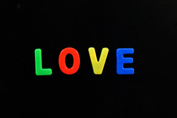 English letters in black background are the words love