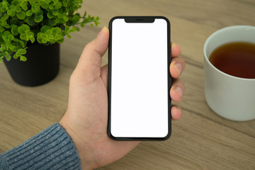 Male hand holding black touch phone with isolated screen