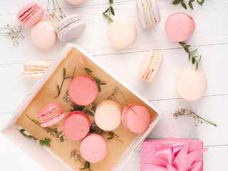 Wall Murals Macarons Colorful macaroons, Colorful french dessert, traditional french colorful macarons in a rows in a box