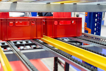Red plastic boxes in the cells of the automated warehouse.