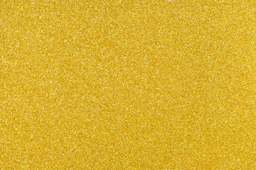 gold sparkling glitter texture background.holiday festive backdrop.