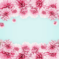 Pastel pink flowers on light blue. Floral frame . Creative layout