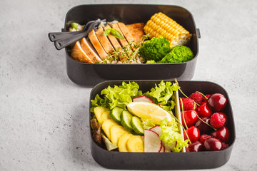 Healthy meal prep containers with grilled chicken with fruits, berries, rice and vegetables. Takeaway healthy food.