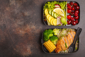Healthy meal prep containers with grilled chicken with fruits, berries, rice and vegetables. Takeaway food, copy space