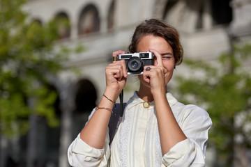 solo travel woman taking photos on european holiday adventure