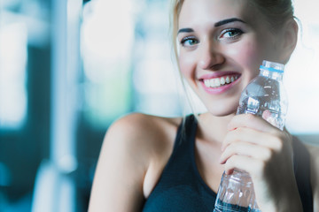attractive caucasian woman relax with pure water after workout with happiness and joyful in gym healthy ideas concept