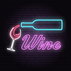 Retro neon wine sign on brick wall background.