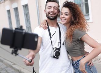 Happy traveling couple making selfie, romantic mood.