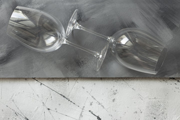 Empty wine glasses on a gray background