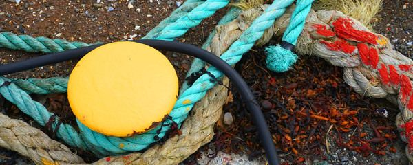 old rope and capstan on a quay