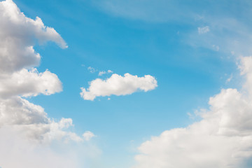 Soft Blue sky in the fluffy white clouds