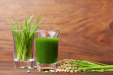 Shot of healthy wheat grass juice. Fitness, diet and detox beverage. Superfood.