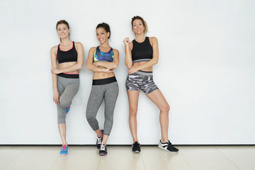 Fitness girls standing on white background