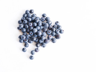 Fresh blueberries on a white background close up, soft focus. Summer wild berry