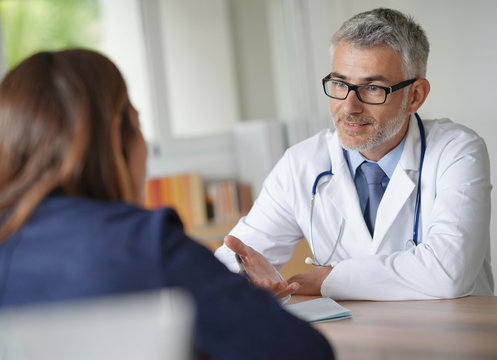 Doctor with patient in clinic room