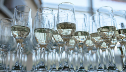 View from below of half full champagne or bubbly flutes, a typical wedding reception or party welcome for the guests