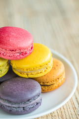 macarons on vintage wooden background. Macaron is sweet.