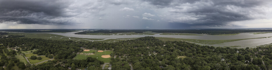 Aerial 180 degree panorama of storm front moving though South Carolina, USA.