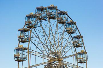top of a ferris wheel against a blue sky