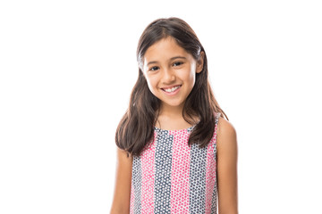 Smiling young hispanic girl posing and looking at the camera over white background Wall mural