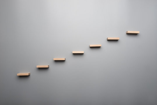 Graph or wooden steps on grey background in a concept of vision